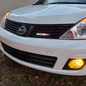 With the new yellow fog light kit and light up nismo emblem in daytime.
