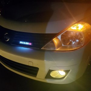 With the new yellow fog light kit and light up nismo emblem at night.